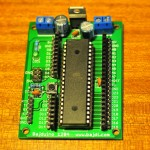 Bajduino 1284: breakout board for the ATmega1284P-PU with male and female headers. The crystal and caps are mounted under the micro controller.